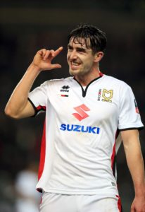 Joe Walsh is a major doubt for MK Dons as they prepare to host bottom club Macclesfield.