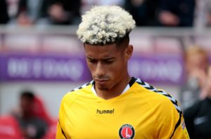 Lyle Taylor scored a hat-trick as Charlton beat Mansfield 5-0 to progress to the second round of the FA Cup.