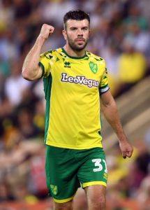 Norwich club captain Grant Hanley has signed a new contract at Carrow Road until 2023.