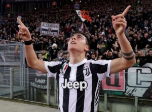Juventus striker Paulo Dybala has played down talk of a move to Bayern Munich and says he is happy with the Bianconeri.