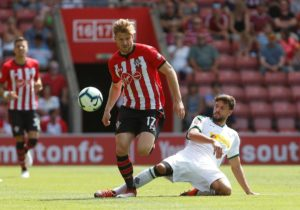 Former Celtic star Stuart Armstrong, who has struggled for game-time since joining Southampton, says he does not miss Scottish football.