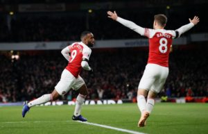 Arsenal striker Alexandre Lacazette says he is happy at the club after a summer of uncertainty in north London.