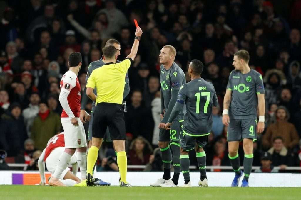 Arsenal have qualified for the knockout stages of the Europa League despite being held to a 0-0 draw against ten-man Sporting Lisbon.
