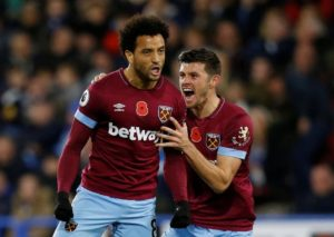 Huddersfield and West Ham defied the wet and windy conditions at the John Smith's Stadium to play out an entertaining 1-1 draw.