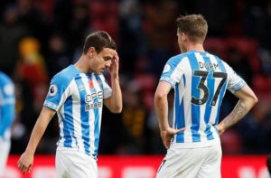 Huddersfield Town have confirmed Chris Lowe will be out until around December with a shoulder injury.