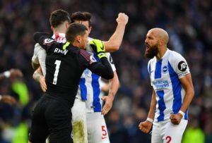 Brighton's Shane Duffy feels his team-mate Lewis Dunk is reaping the benefits of training with England.
