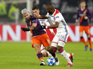 Manchester City twice came from behind to claim a 2-2 draw at Lyon with Aymeric Laporte and Sergio Aguero on target.