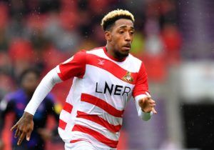 Mallik Wilks netted twice as Doncaster Rovers boosted their League One play-off challenge with a thumping 4-0 victory at struggling Bristol Rovers.