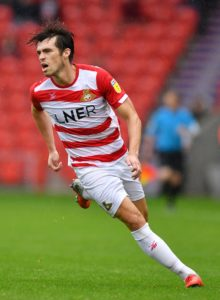 John Marquis scored against his former club to give Doncaster Rovers a 3-1 victory over Gillingham.