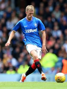 Rangers midfielder Ross McCrorie feels it would be a 'huge' psychological boost to end 2018 on top of the Ladbrokes Premiership.