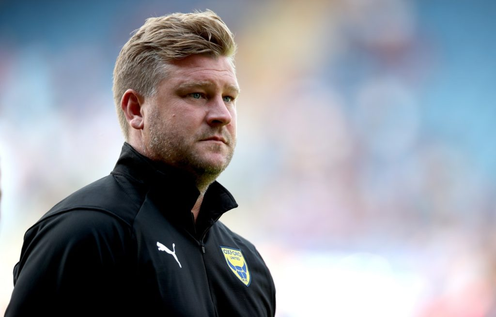Oxford's Liverpool-born manager Karl Robinson is keeping his fingers crossed for a big FA Cup third round tie after winning 2-1 at League One rivals Plymouth.
