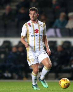 MK Dons recorded their third win in four games with a comfortable 2-0 victory over Carlisle United to retain their spot at the top of League Two.