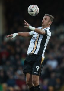 Port Vale scored two late goal to seal a dramatic point from a 2-2 draw against Morecambe at the Globe Arena.