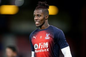 Crystal Palace are without the suspended Wilfried Zaha and James Tomkins for Saturday's Premier League visit of Leicester City.