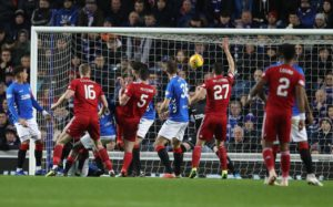 Rangers relinquished their grip on top spot after just three days as Scott McKenna's winner gave Aberdeen only their second Ibrox win in 27 years.