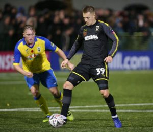 AFC Wimbledon rode their luck before seeing off National League battlers Halifax 3-1 to reach the third round of the FA Cup for the fourth time in five seasons.