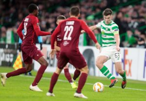 Celtic dramatically won through to the knockout stage of the Europa League despite a 2-1 defeat by Salzburg at Parkhead.