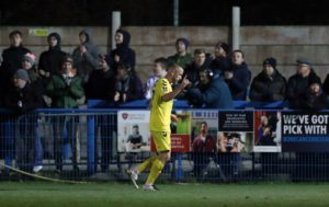 Joey Barton's Fleetwood rode their luck to sink non-league Guiseley and book ahome FA Cup third round clash with Wimbledon.
