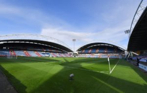 Huddersfield Town Academy winger Olly Dyson has joined non-league Barrow on a short-term deal.