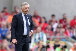 Napoli boss Carlo Ancelotti says he was proud of his side as they went out of the Champions League against Liverpool.