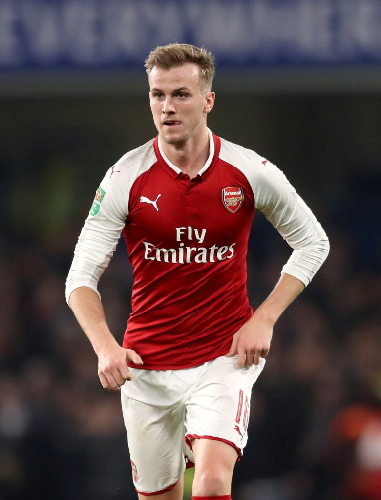 Rob Holding will miss Arsenal's visit of Huddersfield on Saturday due to a knee injury and he could be facing at a long-term absence.
