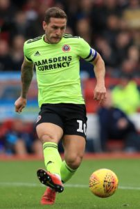 Sheffield United moved up to third in the Sky Bet Championship with a hard-earned 2-0 victory at managerless Reading.