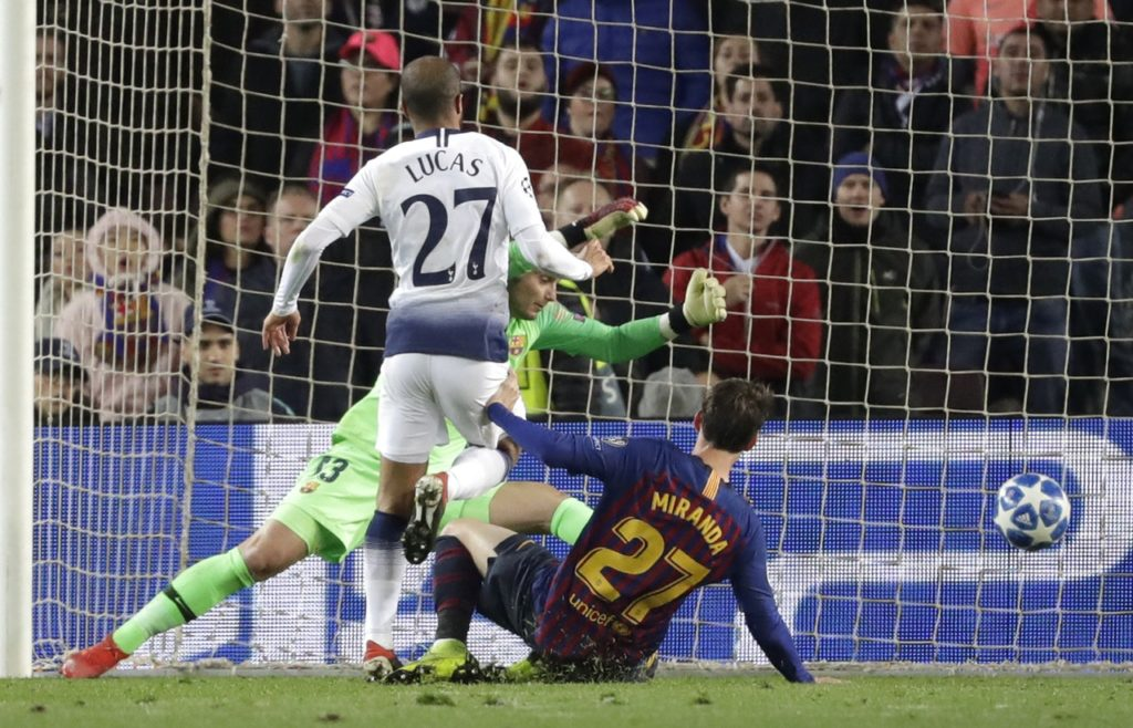 Lucas Moura's dramatic late goal sent Tottenham through to the Champions League knockout stages by earning a 1-1 draw at Barcelona.