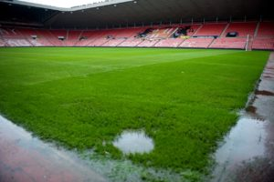 Forest Green's match against Mansfield was called off at half-time with the score goalless after a torrent of rain led to a waterlogged pitch at the New Lawn.