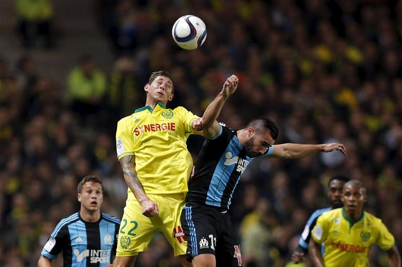 Cardiff City boss Neil Warnock has confirmed he was in France to watch transfer target Emiliano Sala in action for Nantes this week.