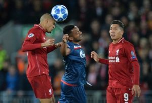 Liverpool midfielder Fabinho has dismissed speculation linking him with Paris Saint-Germain and says he is staying put.