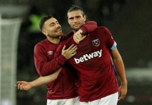 Andy Carroll says he is desperate to convince the West Ham board to keep him at the club beyond the summer.