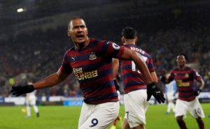 Newcastle collected what could prove to be a huge three points in their battle for survival after they beat fellow strugglers Huddersfield 1-0.