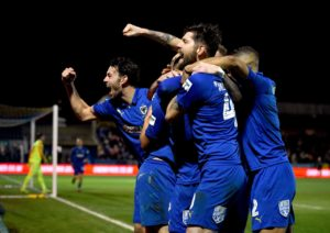 Wally Downes has urged his AFC Wimbledon players to use their FA Cup heroics as a springboard to pull off the 'great escape'.