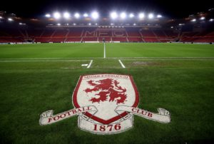 Banning orders have been issued to 12 fans after an investigation into crowd trouble at Middlesbrough's home game against Millwall last season.