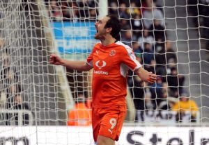 Luton will be without striker Danny Hylton for the FA Cup third-round replay against Sheffield Wednesday.