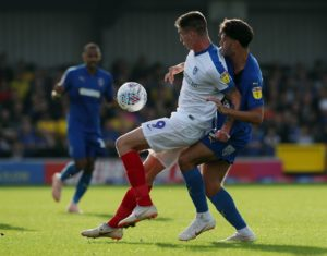 Portsmouth will be without striker Oli Hawkins for Saturday's Sky Bet League One clash against Blackpool at Fratton Park.