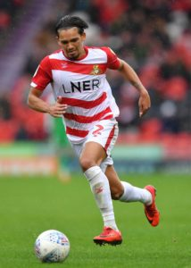 Doncaster have suspended defender Niall Mason following his conviction for sexual assault.