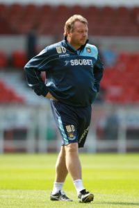 Wally Downes wants AFC Wimbledon to play a waiting game in a bid to topple Premier League foes West Ham in Saturday's FA Cup clash.