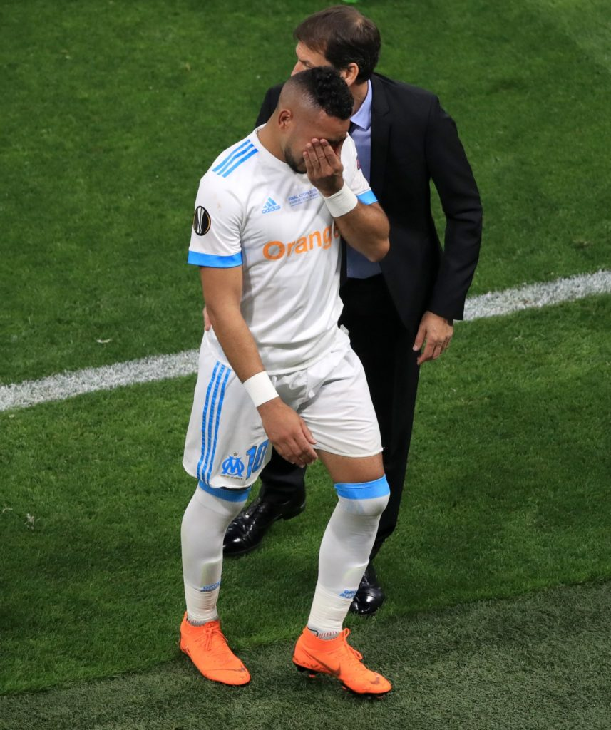 Rudi Garcia says Marseille may have to make do without Dimitri Payet for a while after he was taken off with a knee injury in Sunday's win at Caen.