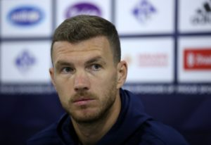 Roma striker Edin Dzeko could face a lengthy ban after appearing to spit at the referee during Wednesday night's Coppa Italia thrashing at Fiorentina.