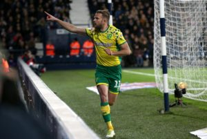 Norwich substitute Jordan Rhodes rescued a point from a 1-1 Sky Bet Championship draw with promotion rivals West Brom at the Hawthorns.