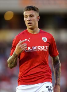 Luton have signed midfielder George Moncur from Barnsley for an undisclosed fee.