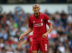 Liverpool midfielder Fabinho insists he is happy with his new role at the heart of defence as he looks to win the Premier League title.