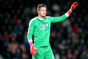 Crystal Palace goalkeeper Wayne Hennessey has denied making a Nazi salute while celebrating his side's FA Cup win against Grimsby.