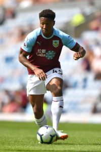 Swindon have signed defender Ali Koiki on loan from Burnley.