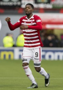 Cheltenham have signed striker Rakish Bingham on a short-term contract following his release by Scottish Premiership side Hamilton.