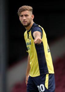 Northampton have signed Scunthorpe defender Charlie Goode on loan.