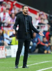 Diego Simeone was delighted to see Atletico Madrid turn up the pressure on La Liga leaders Barcelona by beating Huesca on Saturday.