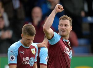 Huddersfield Town remain at the foot of the Premier League table after losing 2-1 to Burnley at the John Smith's Stadium.