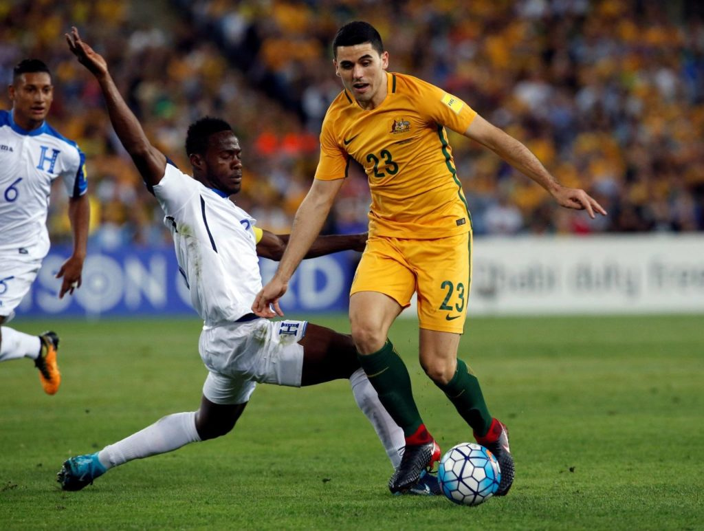 Australia coach Graham Arnold says he could alter his formation for the Asian Cup tie with UAE due to Tom Rogic's suspension.